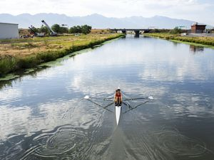 (Rick Egan   The Salt Lake Tribune) Kathleen Noble trains on the Jordan River in Salt Lake City, Thursday, July 8, 2021. Noble is the first rower to qualify from Uganda. She will compete at the Tokyo Olympics in single scull rowing.