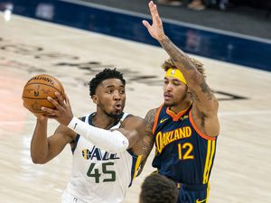 (Rick Egan | The Salt Lake Tribune) Utah Jazz guard Donovan Mitchell (45) takes the ball down court, as Golden State Warriors guard Kelly Oubre Jr. (12) defends, in NBA action between the Utah Jazz and the Golden State Warriors at Vivint Arena, on  Saturday, Jan. 23, 2021.