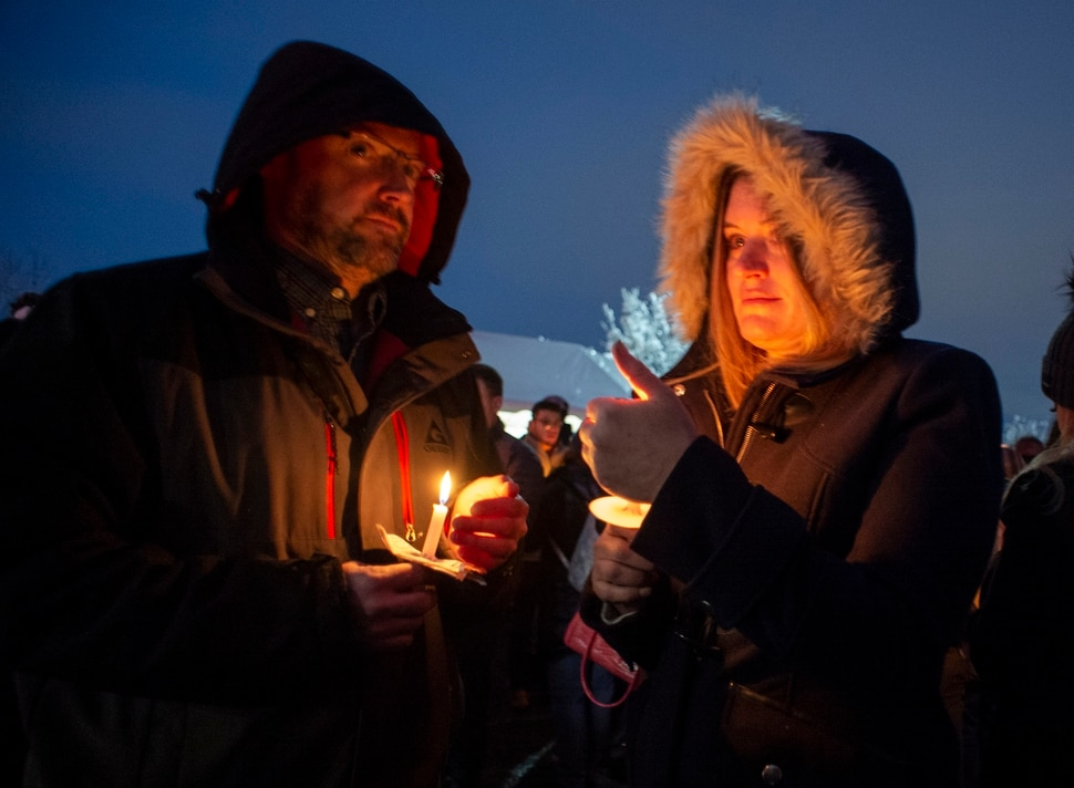 (Rick Egan | The Salt Lake Tribune) Tim and Kim McCann, from Alpine, hold candles during a candlelight vigil for David Stokoe, a real estate agent killed at one of his rentals last week. Monday, Jan. 21, 2019.