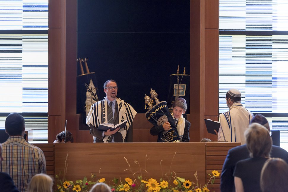 Courtesy | Deborah DeKoff Rabbi David Levinsky (l). Temple Har Shalom's new rabbi, officiates at the bar mitzvah of Asa Torok (middle), with the help of Michael Greenfield (r).