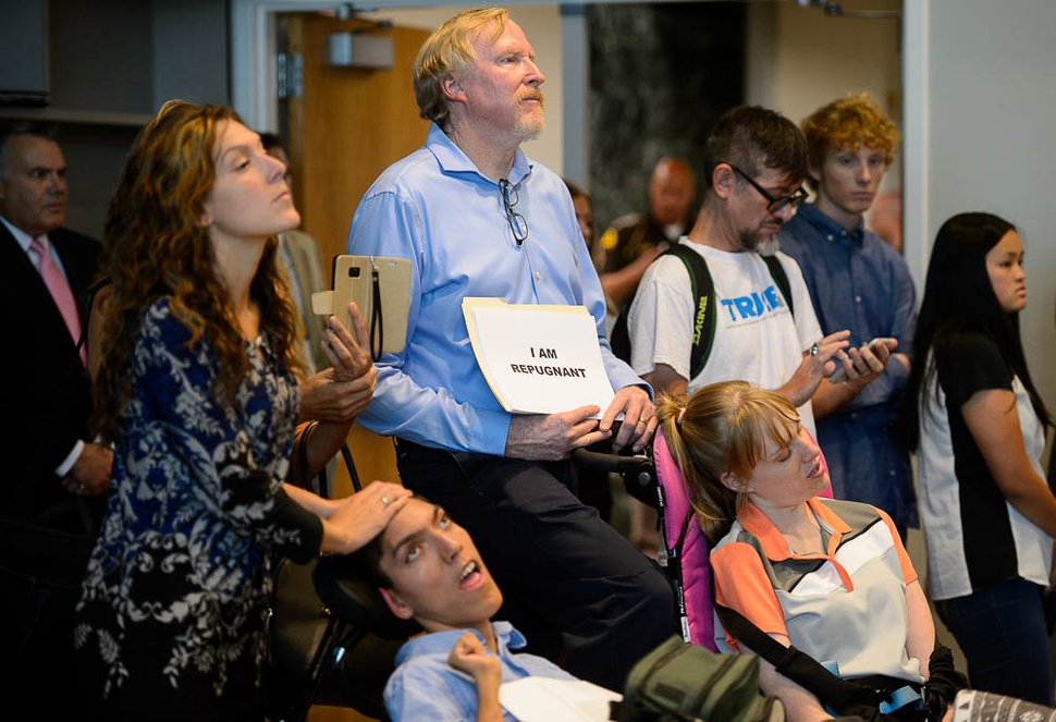 (Trent Nelson   The Salt Lake Tribune) Protestors at a news conference where a coalition including the LDS Church came out against Utah's medical marijuana initiative, in Salt Lake City on Thursday Aug. 23, 2018.