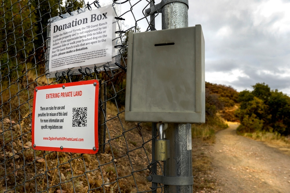 Leah Hogsten | The Salt Lake Tribune Ogden landowner Chris Peterson has signs posted Oct. 10, 2018 along the Bonneville Shoreline Trail, running through his TR Guest Ranch, a property that encompasses the Ogden foothills from 29th Street to the ridge of Malan's Basin. This sign on the Waterfall Canyon trail reads Unlike the National Forest, the TR Guest Ranch is private property and is not supported by tax dollars. If you appreciate being able to hike or mountain bike or walk your leased dog on the four TR Guest Ranch trails that are ope to the public, please make a donation. The 3.75 miles of TR Guest Ranch private trails that are open to the public are a) 29th St. to Waterfall, b) 29th St. to Taylor Canyon, c) Taylor Canyon to Malan Peak and d) the Bonneville Shoreline Trail inside the TR Guest Ranch gates. All other trails and activities on the TR Guest Ranch require a fee and a TR Guide, and can be booked at ZipUtah.com Trail closures are infrequent, but they happen a few times per year, and are normally posted in advance at OgdenFoothillPrivateLand.com.