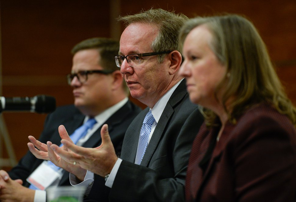 Francisco Kjolseth | The Salt Lake Tribune David Winberg, center, director of the NSA Operations Center in Utah attends a conference at the University of Utah hosted by Congressman Chris Stewart entitled America's Role in the World on Tuesday, Oct. 13, 2015. Also pictured are Scott Simpson of the Utah Credit Union Association and Major General Jennifer Napper (US Army retired), Unsys.