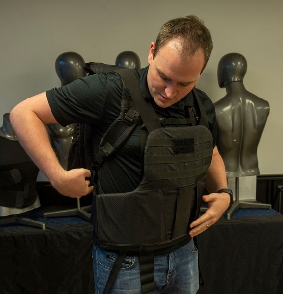 (Rick Egan | The Salt Lake Tribune) Jarrett Casutt demonstrates a backpack bulletproof vest at Citizen Armor, a company in Provo that makes bulletproof backpacks and other products, on Monday, Aug. 5, 2019.