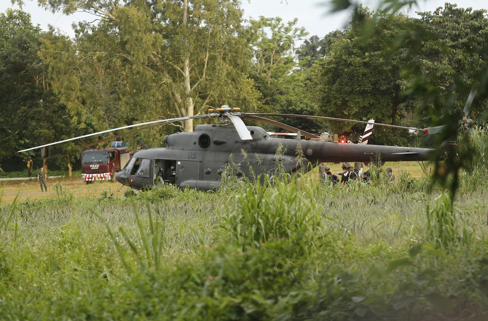 A Thai military evacuation helicopter as the remaining trapped boys and their coach are extracted from a cave in Mae Sai, Chiang Rai province, northern Thailand on Tuesday, July 10, 2018. Thai Navy SEALs say all 12 boys and their coach have been rescued from the cave, ending an ordeal that lasted more than 2 weeks. (AP Photo)