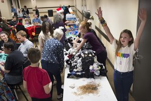 (Scott Sommerdorf   |  The Salt Lake Tribune)    Savvanah raises her arms after she and other volunteers had finished sorting socks to be included in care packages for LGBT+ youth experiencing homelessness in the area, Thursday, December 14, 2017, as Lady Gaga's Born This Way Foundation hosted an event at the Maverick Center to assemble the gifts.  Savannah has been collecting donated blankets, toiletries, backpacks and other essential items for the care packages, and Lady GagaÕs fans will be invited to support her efforts by donating such items at her Salt Lake City concert that evening.
