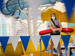 (Trent Nelson  |  The Salt Lake Tribune) Lifeguard Lainey Vander Linden at the Draper Recreation Center on Monday, May 10, 2021. A mask mandate remains in effect at Salt Lake County facilities, though some GOP officeholders are seeking to change that.