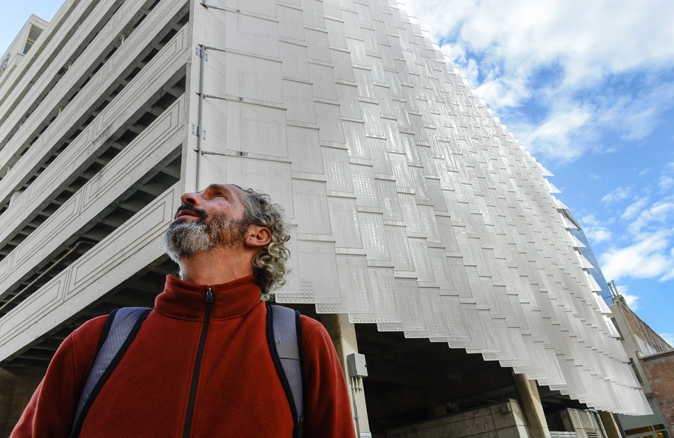 (Francisco Kjolseth | The Salt Lake Tribune) Salt Lake City's largest piece of public art is completed as artist Ned Kahn takes in the space where his completed work entitled Pages of Salt, that consists of 336 teflon flags, mounted on stainless steel rods, on the side of the Walker Center garage comes alive when the wind blows.