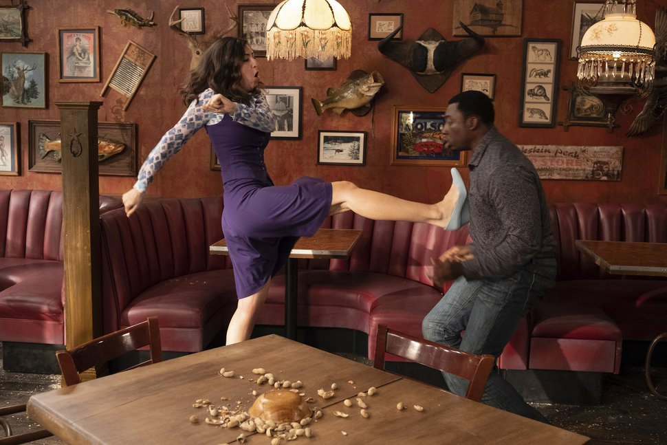 (Colleen Hayes | NBC) D'Arcy Carden as Janet and Bambadjan Bamba as Bambadjan in a scene from
