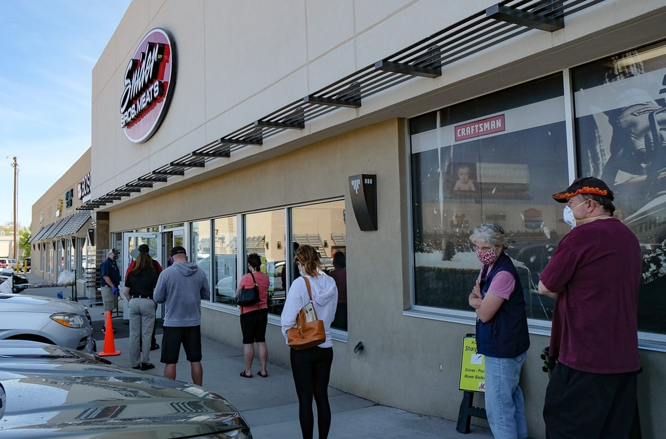 (Francisco Kjolseth | The Salt Lake Tribune) People line up outside of Snider Brothers Meats in Cottonwood Heights on Tuesday, May 5, 2020, as they limit the number of people inside the store.