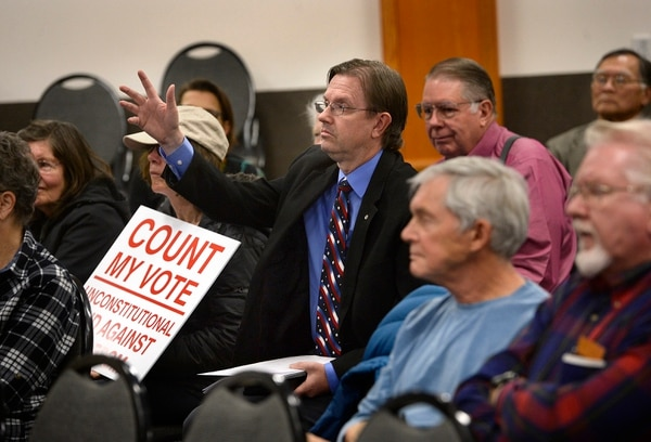 (Scott Sommerdorf | The Salt Lake Tribune) Former Utah Rep. Fred Cox tries to get recognized in order to ask a question during the Count My Vote public hearing at the Whitmore Library in Cottonwood Heights, Friday, Oct. 27, 2017. The Count My Vote ballot initiative seeks to select party nominees through a direct primary, in addition to the traditional caucus-convention system.