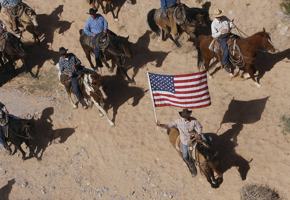 (Jason Bean | Las Vegas Review-Journal file photo via AP) In this April 12, 2014, file photo, the Bundy family and their supporters fly the American flag as their cattle is released by the Bureau of Land Management back onto public land outside of Bunkerville, Nev.