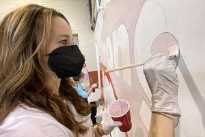 (Rick Egan   The Salt Lake Tribune) Utah first lady Abby Cox works on a mural during a day of service at the Utah YWCA on Tuesday, March 2, 2021.