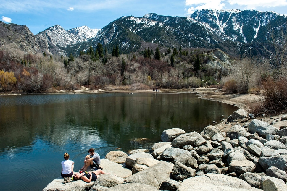 (Rick Egan | The Salt Lake Tribune) Hikers take a rest on the banks of Lower Bell Canyon Reservoir, Tuesday April 7, 2020