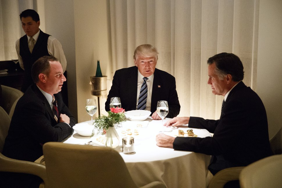 (Evan Vucci | AP file phot) President-elect Donald Trump, center, eats dinner with Mitt Romney, right, and Trump Chief of Staff Reince Priebus at Jean-Georges restaurant, in New York on Nov. 29, 2016. Trump briefly considered Romney for secretary of state.