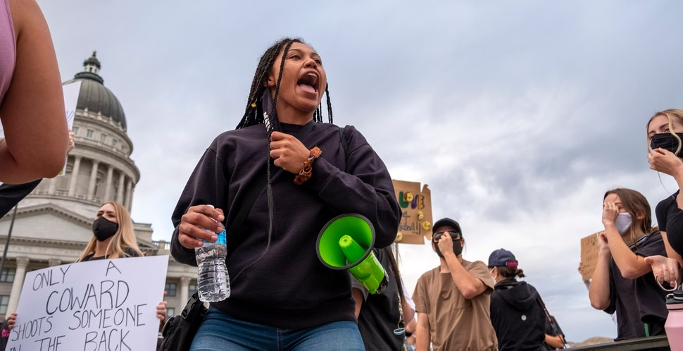 Rae Duckworth refocuses the group with chants after an anti-protester showed up. Black Lives Matter supporters and Salt Lake Equal Rights Movement members march from the Capitol to Washington Square on Monday August