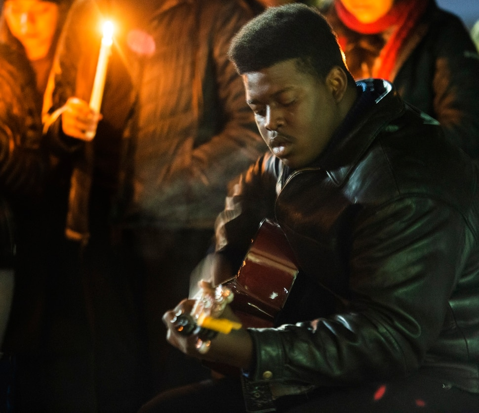 (Rick Egan | The Salt Lake Tribune) Nate Byrd, president of the BYU Black Student Union, sings a song during a candlelight vigil on BYU campus, for the student who died by suicide this week, at the Tanner Building, Friday, Dec. 7, 2018.