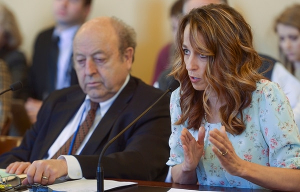 (Leah Hogsten | The Salt Lake Tribune) l-r Senator Lyle Hillyard, R-Logan listens as Abby Cox gives reasons not to repeal SB126 regarding surrogacy Wednesday, February 7, 2018 in the Senate Health and Human Services Committee at the Capitol. Cox, wife of Lt. Gov. Spencer Cox, said she was a gestational carrier for her sister-in-law seven years ago.