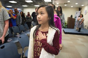(Scott Sommerdorf   |  The Salt Lake Tribune)  Children recite the Pledge of Allegiance during a ceremony in recognition of children who have obtained citizenship through their parents, Thursday, December 28, 2017. Some were adopted by U.S. citizen parents; others derived citizenship when their immigrant parents became naturalized citizens.