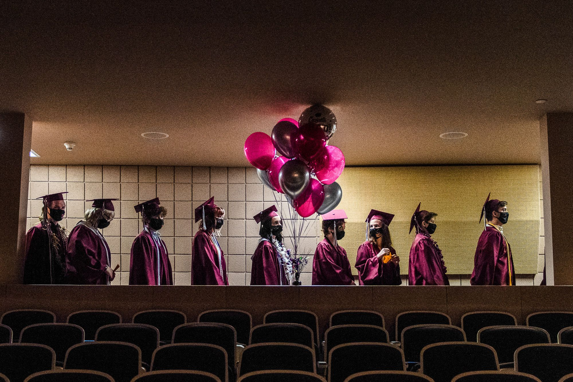 (Briana Scroggins | Special to The Tribune)  The Salt Lake School for the Performing Arts graduates line up before walking to their seats during graduation at Highland High School in Salt Lake City on Wednesday, June 2, 2021.