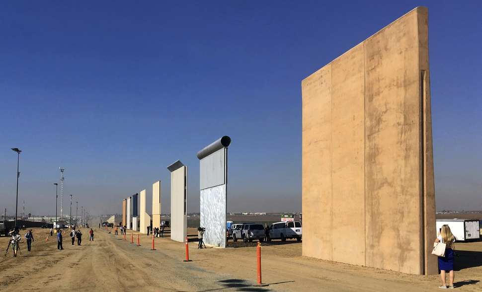 (Elliott Spagat | Associated Press file photo) This Oct. 26, 2017 file photo shows prototypes of border walls in San Diego. Rigorous testing of prototypes of President Donald. A U.S. official says recent testing of prototypes of President Donald Trump's proposed wall with Mexico found their heights should stop border crossers. U.S. tactical teams spent three weeks trying to breach and scale the models in San Diego. An official with direct knowledge of the results said they point to see-through steel barriers topped by concrete as the best design. The official spoke to The Associated Press on condition of anonymity because the information is not authorized for release.