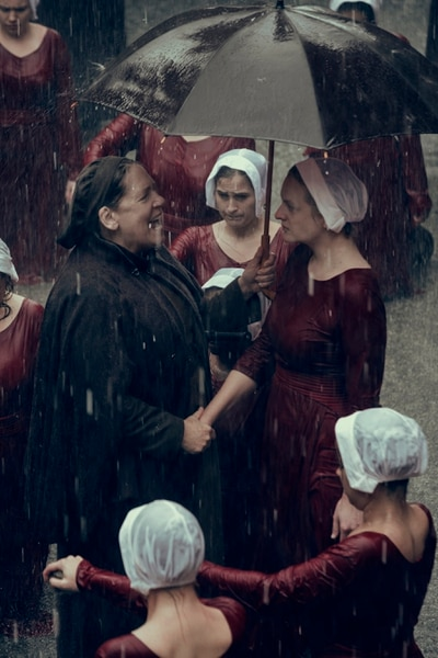 "(Photo Credit: George Kraychyk/Hulu) Ann Dowd as Aunt Lydia and Elisabeth Moss as Offred/June in the Season 2 premiere of ""The Handmaid's Tale."""