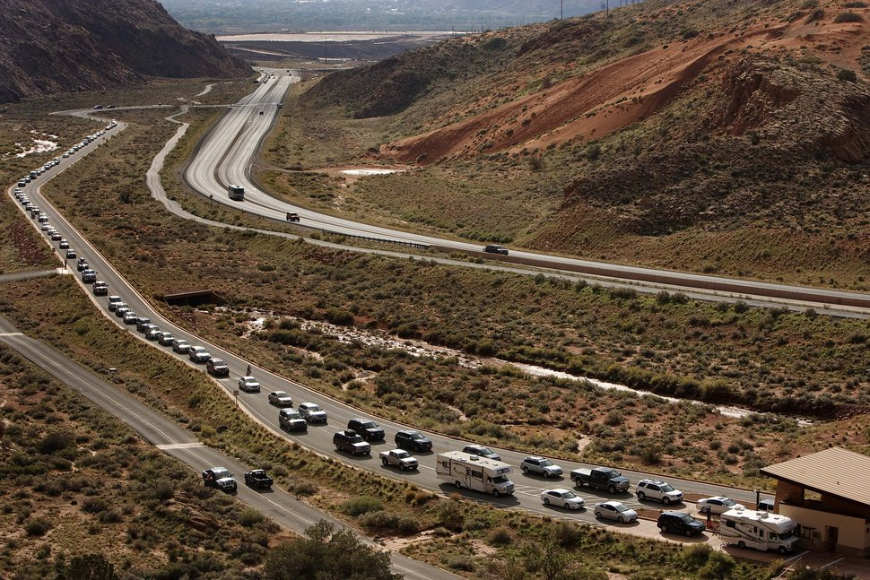 (Leah Hogsten | Tribune file photo) This Oct. 12, 2013, file photo shows a bumper-to-bumper line of cars on the road to Arches National Park. The temporary government shutdown complicated things just in time for what is a traditionally busy fall weekend in Moab and the nearby national parks.