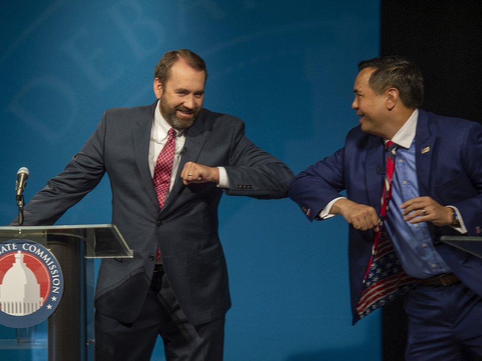 (Rick Egan | Tribune file photo) David Leavitt and Sean Reyes, candidates for Utah attorney general bump elbows after their debate at KUED, June 2, 2020.