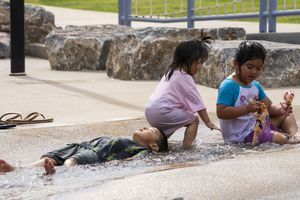 (Rick Egan   The Salt Lake Tribune) Kids cool off in the water at Fairbourne Station in West Valley City, on Monday, June 7, 2021.
