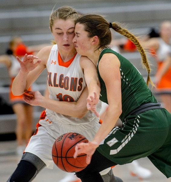 (Steve Griffin | The Salt Lake Tribune) Hillcrest's Gabrielle Desjardins, right, crashes into Skyridge's Ally Blackham during game at Skyridge High School in Lehi Wednesday December 13, 2017.