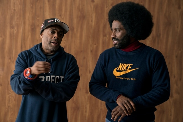 (David Lee | courtesy Focus Features) Actor John David Washington (right) talks with director Spike Lee on the set of