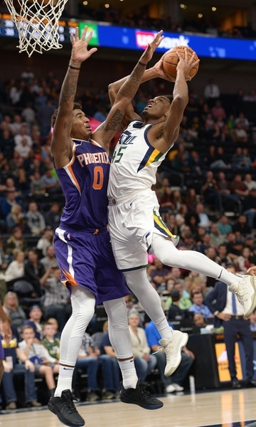 (Leah Hogsten | The Salt Lake Tribune) Utah Jazz guard Donovan Mitchell (45) rounds Phoenix Suns forward Marquese Chriss (0) to hit the net. The Utah Jazz defeated the Phoenix Suns 112-101 during preseason NBA basketball at Vivint Smart Home Arena in Salt Lake City, October 6, 2017.
