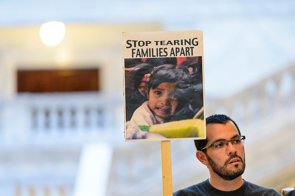 (Trent Nelson | The Salt Lake Tribune) Leonel Nieto holds a sign at a rally at the State Capitol building in Salt Lake City to remind Senator Hatch and Senator Lee that DACA is #HereToStay, Thursday August 31, 2017.