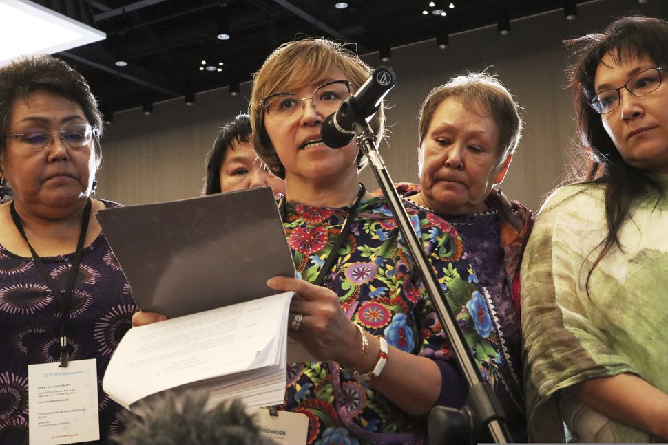 (Emily Schwing/Reveal via AP) In this Oct. 20, 2018, photo, Elsie Boudreau, center, speaks at the Alaska Federation of Natives conference in Anchorage, Alaska. After going public with her story of abuse, Boudreau became an advocate for other survivors in Alaska Native communities through her nonprofit Arctic Winds Healing Winds organization. From left, are Alma Elia, Nancy Andrew (partly hidden), Boudreau, Florence Busch and Anna Sattler