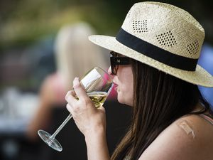 (Isaac Hale   Special to The Tribune) Marissa Nichols Giron takes a sip of her glass of wine while she and her husband Trevor Giron have dinner at Kimi's Chop and Oyster House in Sugar House on Friday, July 9, 2021.