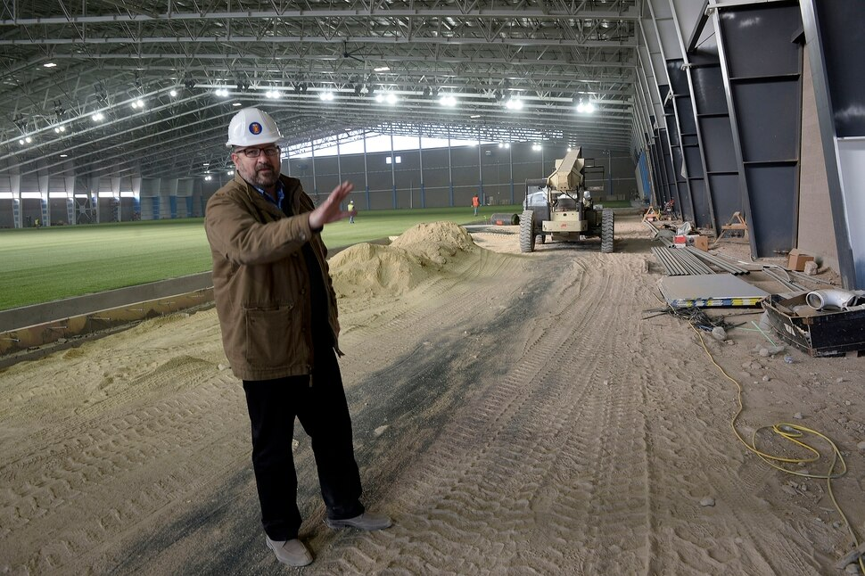 (Al Hartmann | The Salt Lake Tribune) Dan Boyd, with Wasatch Restaurant Group shows area area for food and concessions in the the RSL Academy charter school's indoor soccer arena. It's huge. Housing two side by side soccer fields, seating and a concessions area. It's believed to be the largest pre-fabricated single span building in the world. It will open mid January 2018.