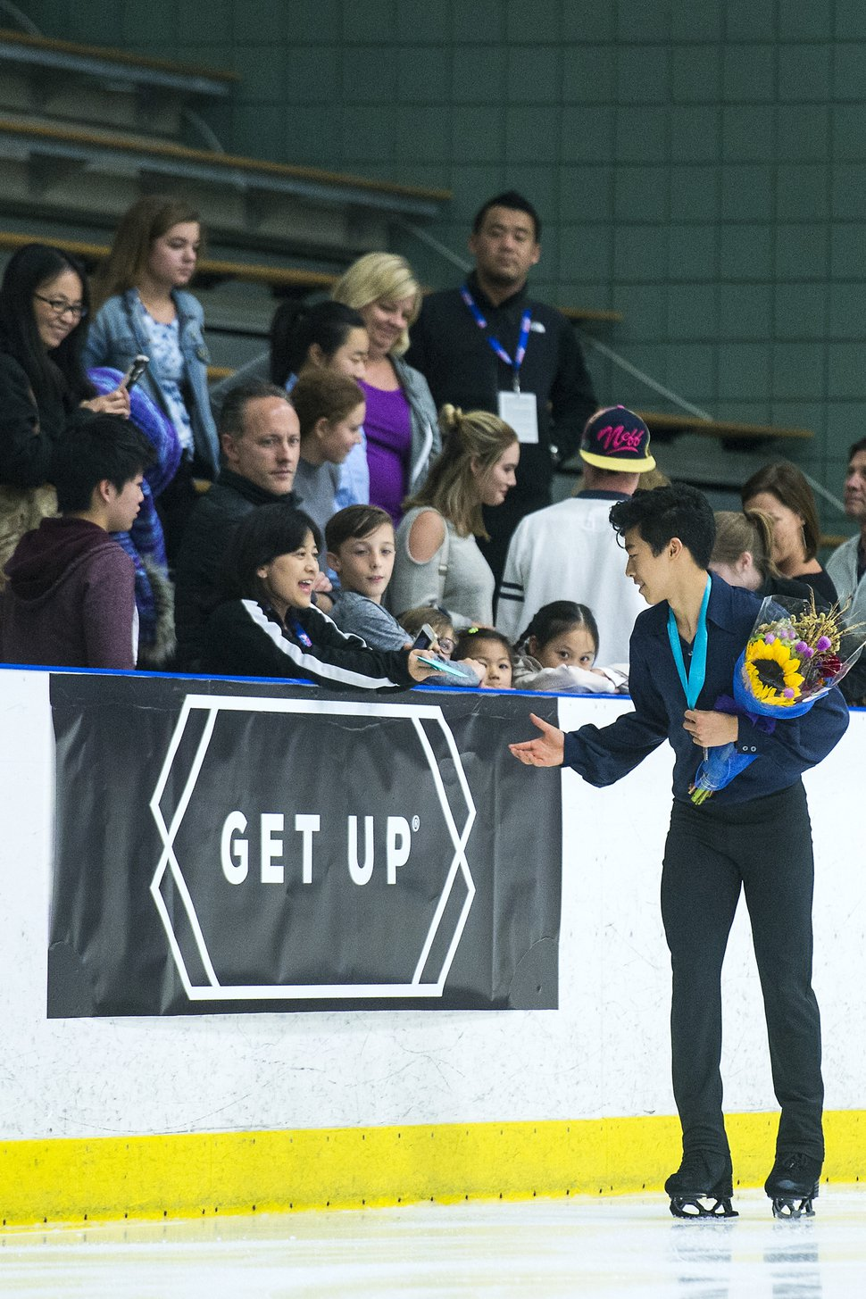 (Chris Detrick | The Salt Lake Tribune) Nathan Chen greets members of the crowd after winning the Men's Free Skate during the U.S. International Figure Skating Classic at the Salt Lake City Sports Complex Friday, Sept. 15, 2017.