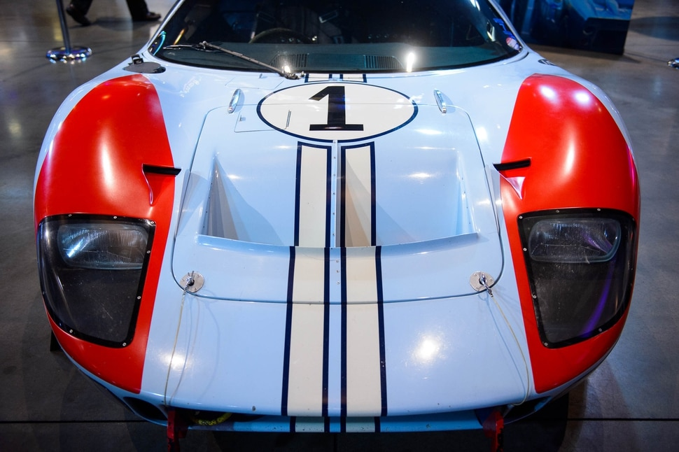 (Trent Nelson | The Salt Lake Tribune) Gail Miller speaks as Megaplex Theatres celebrates its 20th anniversary at an event at The District location in South Jordan on Thursday Nov. 14, 2019. On display is a 1966 Ford GT40 Mark II.