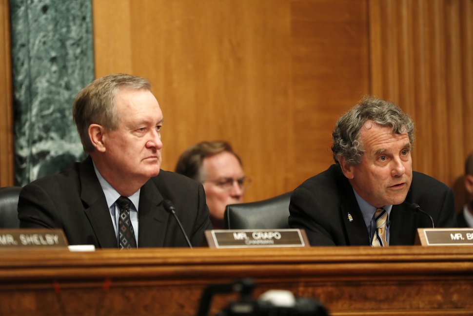 Senate Banking Committee Chairman Sen. Mike Crapo, R-Idaho, left, and the committee's ranking member Sen. Sherrod Brown, D-Ohio, listen on Capitol Hill in Washington, Thursday, July 13, 2017, as Federal Reserve Chair Janet Yellen testified before the committee. (AP Photo/Pablo Martinez Monsivais)