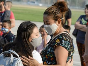 (Chris Samuels | The Salt Lake Tribune) Parents say goodbye to students as they begin the first day of school at Whittier Elementary in West Valley City, Monday, Aug. 16, 2021. Doctors are now trying to combat myths they say are leading some families to not send their kids back masked up.