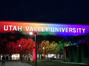 (Emily Branvold) Pictured is the UCCU Center at Utah Valley University lit up in rainbow colors for an LGBTQ graduation celebration for 2021.