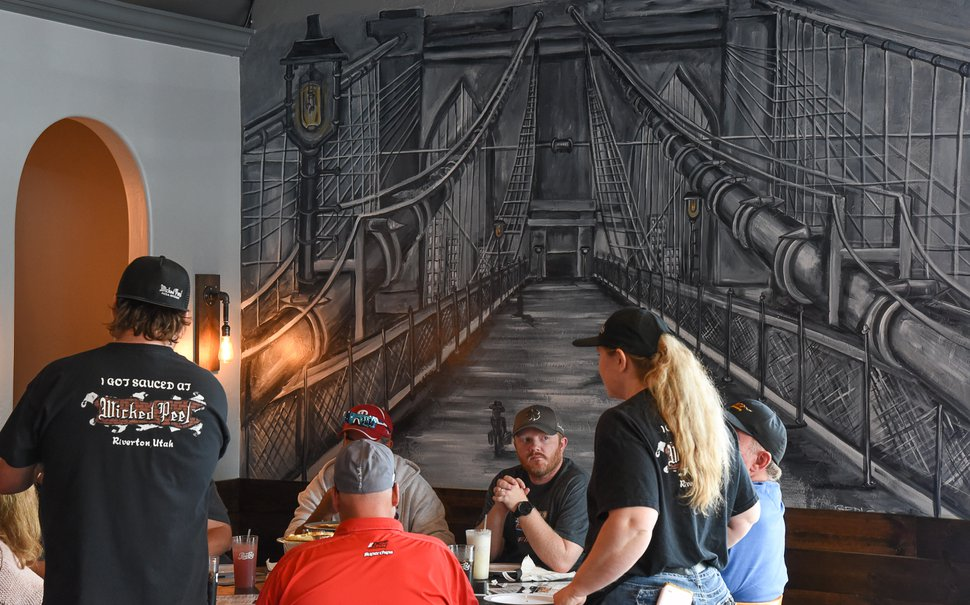 (Francisco Kjolseth | The Salt Lake Tribune) Murals adorn Wicked Peel Pizza Kitchen in Riverton as Charlie Wallwork and his wife, Marylee, take orders from customers.
