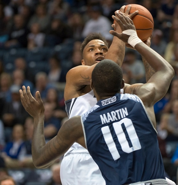 (Rick Egan | The Salt Lake Tribune) Brigham Young Cougars guard Jahshire Hardnett (0) shoots over Rice Owls forward Robert Martin (10), in basketball action between Brigham Young Cougars and Rice Owls, at the Marriott Center in Provo, Wednesday, Nov. 21, 2018.