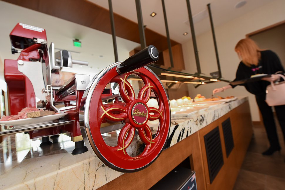 (Francisco Kjolseth | The Salt Lake Tribune) Hannah Mohler, breakfast host at the new AC Hotel in Salt Lake City, uses the $10,000 Berkel prosciutto slicer to cut paper-thin slices of cured meat.