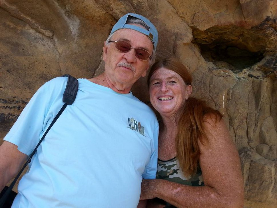 (Photo courtesy Thayes Ann Hewitt) George and Thayes Ann Hewitt, of Diamond Valley, Utah, pose for this photo in 2017. George Hewitt died of COVID-19 on July 6, 2020, at home.