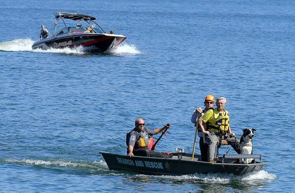 (Eli Lucero | Herald Journal) Members of Search and Rescue look for a swimmer on Friday, May 25, 2018, in Hyrum Reservoir.