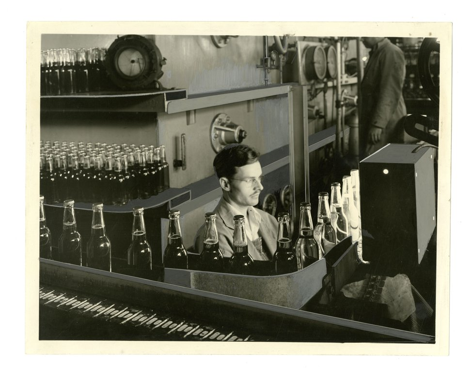 Courtesy | Utah State University Merril-Cazier Library, Special Collections and Archives Division In this historical photo, an employee performs quality control at the Becker Brewing and Malting Factory, in Ogden.