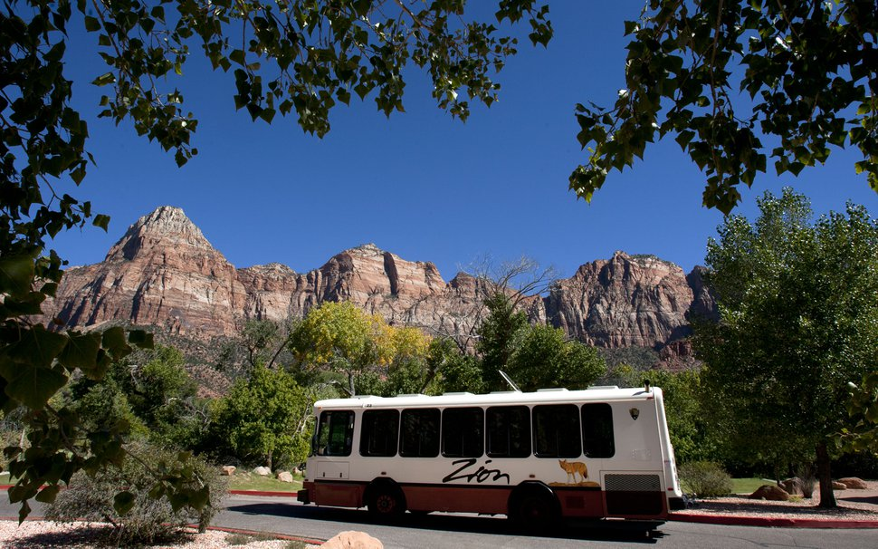 (Tribune file photo) A shuttle bus leaves the Zion Canyon Village.