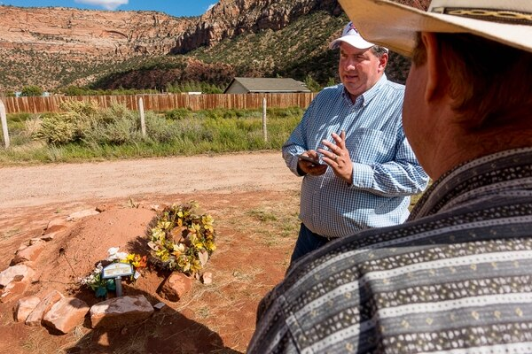 Trent Nelson | The Salt Lake Tribune Dowayne Barlow and Isaac Wyler stand over Walter Steed's grave at the Isaac W Carling Memorial Park Cemetery in Colorado City, Ariz., Wednesday, Sept. 16, 2015.