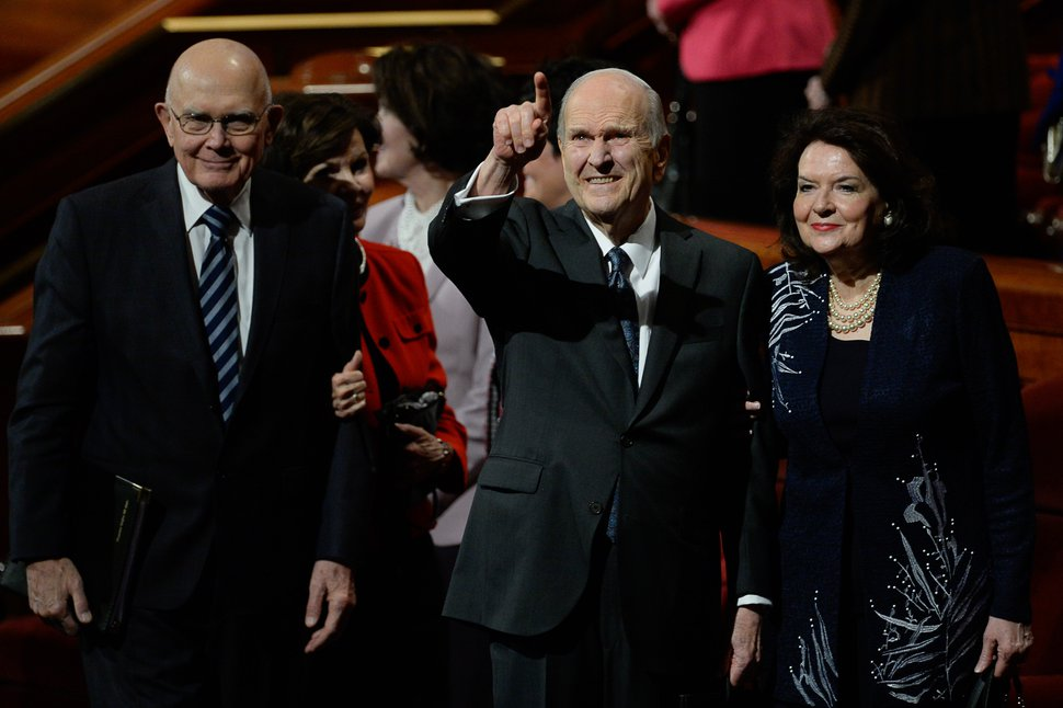 (Francisco Kjolseth | The Salt Lake Tribune) President Russell M. Nelson acknowledges the crowd as he and his wife, Sister Wendy Nelson, exit at the conclusion of the 189th twice-annual General Conference of The Church of Jesus Christ of Latter-day Saints at the Conference Center in Salt Lake City on Sunday, Oct. 6, 2019. At left is President Dallin H. Oaks, first counselor in the First Presidency of The Church of Jesus Christ of Latter-day Saints